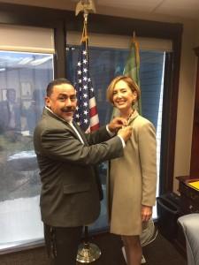 Mayor Richard De La Rosa giving Soheila Azizi de Pin of Colton
